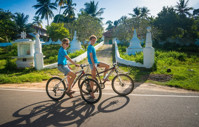 tourists riding bicycles in Sri Lanka
